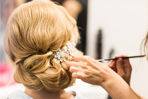 Woman having a diamonte clip fastoned to bridal hair for a special occasion